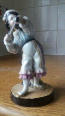 mid to late 19th century porcelain violin player