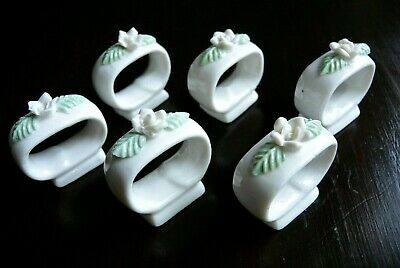 Lovely vintage set of  6 porcelain napkin rings with raised flower design