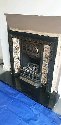 Decorative Cast Iron Reproduction gas Fire with Surround and Ornate Tiles