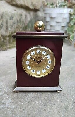 A fine quality 15 Jewel Lever Swiss alarm clock by Looping - Working fine