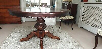 Mahogany round extendable dining table  and 4 chairs
