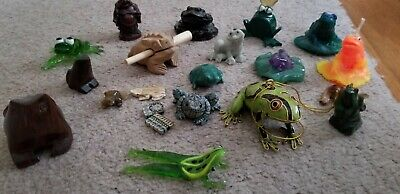 Collection of small frog figurines, variety of rock, wood, jade, and glass