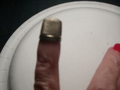 small vintage sterling silver thimble, used