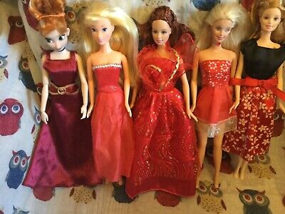 bundle of barbie and disney dolls with clothes christmas colours red and gold