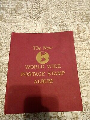 Vintage WORLDWIDE COLLECTION IN POSTAGE STAMP ALBUM used
