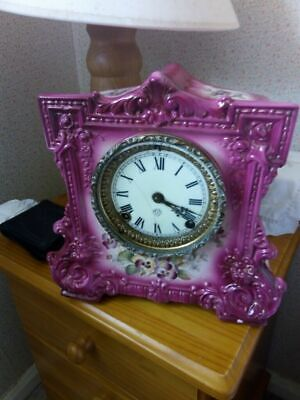 Ansonia Antique Clock 1882 in Wicket Ceramic Casing