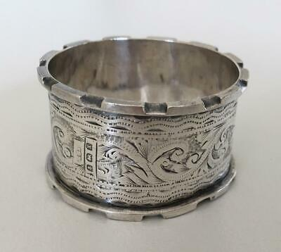 Extremely ornate English sterling silver napkin ring w top of a fort edges 1923