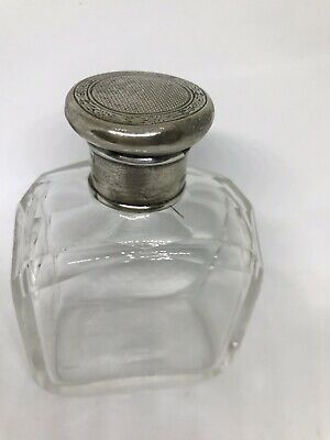 C 1931 cut glass perfume bottle with hallmarked sterling cap