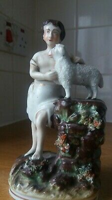 mid to late 19th century?staffordshire pottery figure boy with sheep