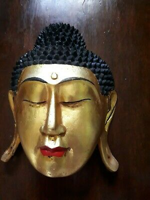 Hand carved Buddha Mask from Bali. In hard wood.