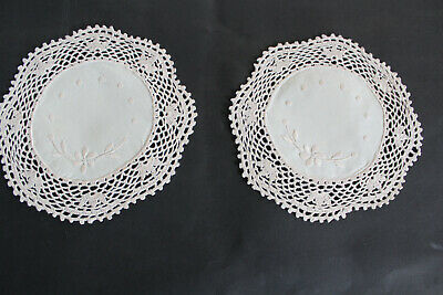 Two vintage ecru round doilies with hand embroidered ecru flowers.
