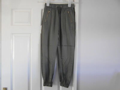 H&M new with tags a size 8/9 years and Khaki in colour trousers
