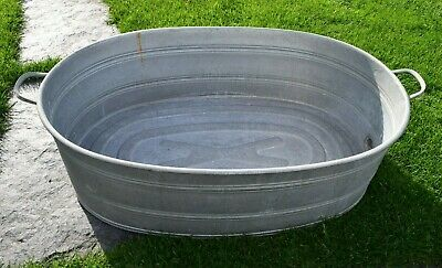 Old Washtub with Drain - Oval - Planter. (262-19)