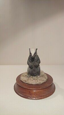 Badger ornament on wooden stand by leonardo