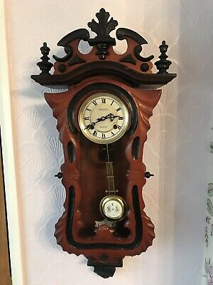 Vintage 31day Orient windup pendulum wall clock in two shades of wood