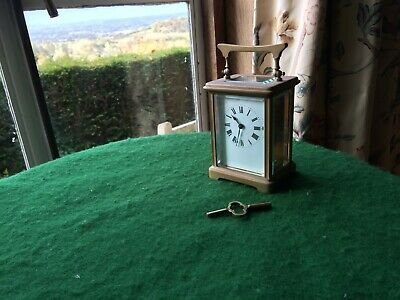 Edwardian brass  8 Day  carriage CLOCK + key good working order(12 cms height )