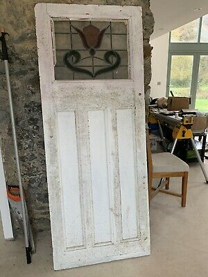 Antique pine door with stained glass window