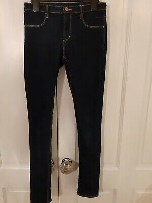 Girls H and M skinny navy jeans hardly worn. Age 12 to 13 years.