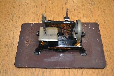 German miniature toy sewing machine in wooden box