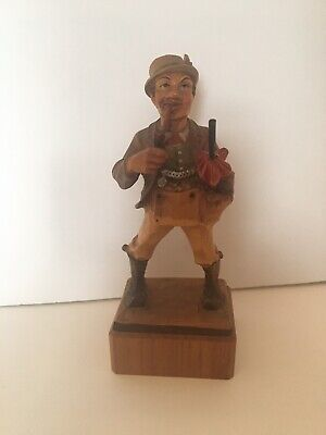 Anri Wood Carving of a Man Carrying an Umbrella Smoking a Pipe