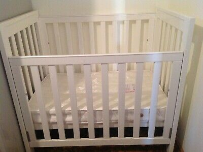 Small Sized Baby Cot (excellent condition) with many extras.