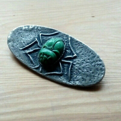 An Art Deco Egyptian Revival Green Hardstone Scrab Pewter Brooch