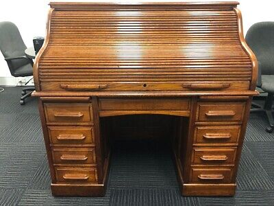 Roll top desk - Oak,  Cutler style.  Good condition. Local pickup