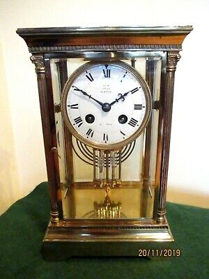 """Brass four Glass Mantel Clock Retailed by  """" Dent """" of London."""