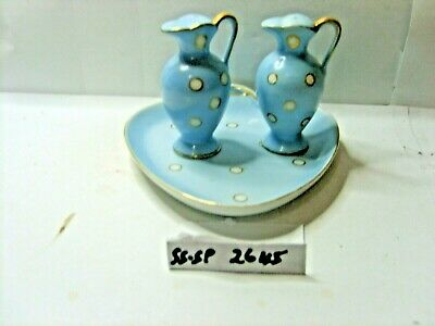jugs on tray  salt and pepper shakers