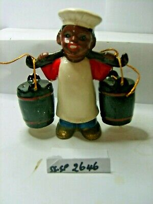 dark person with buckets  salt and pepper shakers