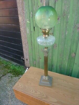 A large antique victorian Oil Lamp with green shade