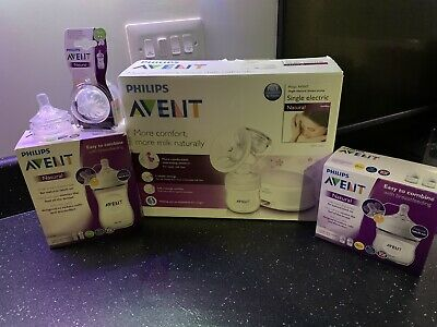 Avent Breast Pump , 4 Bottles And 2 New Teats