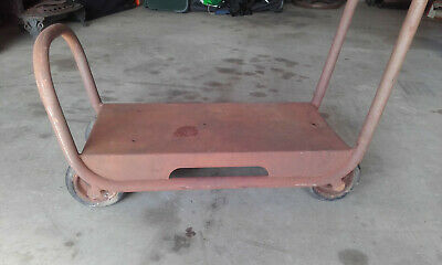 A Vintage collectable rare Industrial Trolley metal patina solid rubber wheels