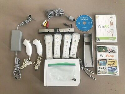 Nintendo Wii White Console (NTSC) 4 Controllers 2 Nunchucks Wii Games