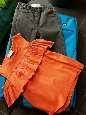 Girls black jeggins and frilly orange top Age 6 Years