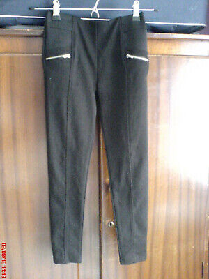 Trousers (girls' black front zips, 8-9 yr, 134 cm Primark, 95% polyester) (new)