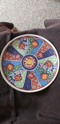 japanese Imari plate red blue gold yellow flower in the middle