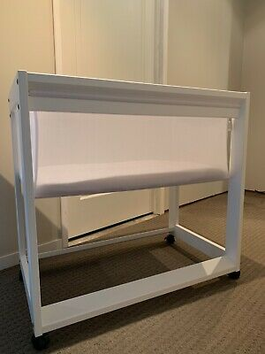 White baby bassinet, excellent condition, mattress included. Smoke free home.