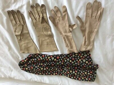 Two pairs of antique leather gloves and a scarf