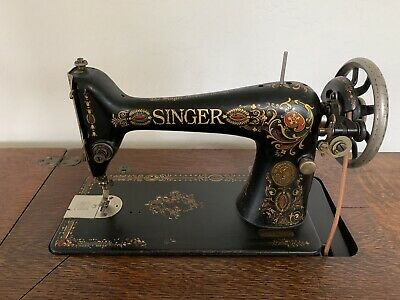 Antique1910 Singer sewing machine w/accessories And 6-drawer Treadle Cabinet...