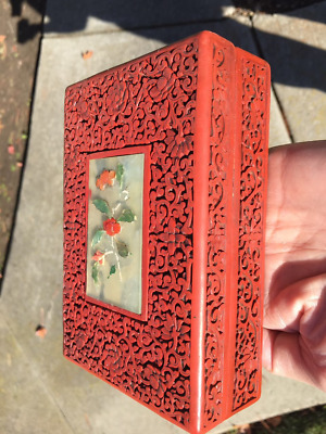 A Chinese Carved Cinnabar Lacquer Covered Box with Inlaid Jade or Stone Decorat