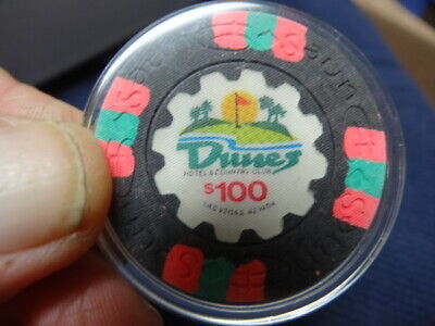 $100 Old casino chip from the Dunes Hotel in Las Vegas