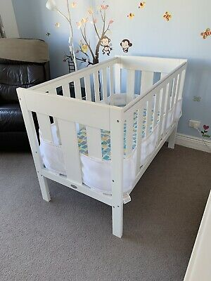 White wooden cot with mattress plus matching change table