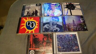 8 x CDs. Oasis. Primal Scream. Stone Roses. Blink 182. Pogues.
