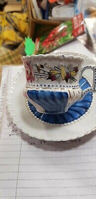 ANTIQUE SMALL GERMAN hand painted PORCELAIN CUP AND SAUCER