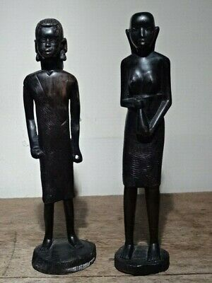 Two Carved Wooden Figures Of An African Man And Woman