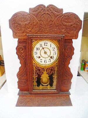 LATE 1800's ANTIQUE E.J.SWIGART( ESJ ) WALNUT CHIMING MANTLE SHELF CLOCK.