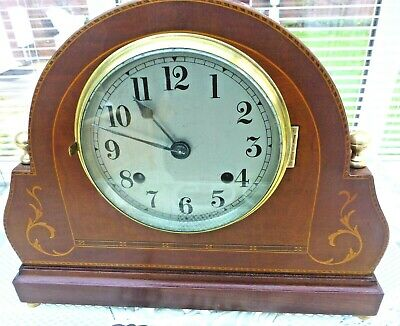 An 8 day Mantel clock in Mahogany with inlays Strikes half & hour fully serviced