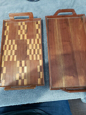 Pair of small antique hand made wooden nesting trays, one with inlays.