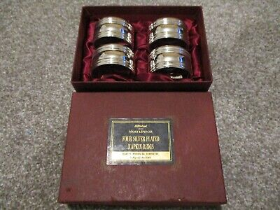 Marks And Spencers Four Silver Plated Napkin Rings Unused Boxed.